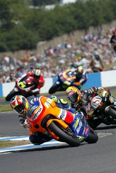 Nieto leads Poggiali in the closing stages of the 250cc British GP.