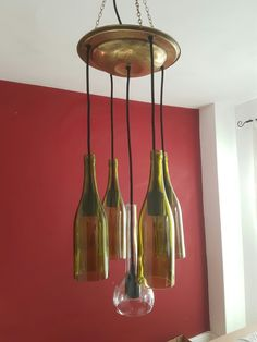 A completely unique light made using 4 green wine bottles and 1 clear ouzo bottle combined with an antique brass plate that was made locally in the Cambridgeshire village of Linton. £350 plus postage of £5.99