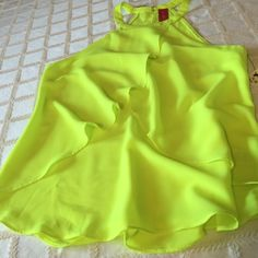 """2/21 HP Neon green yellow sleeveless flowing top Neon green yellow sleeveless poly flowing top is very cute for a night out and very BRIGHT! Hangs beautifully too.  Length center back (2 hook and eye closures and keyhole) to hem is 23.5"""" AKIRA Tops Blouses"""