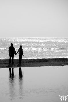 classic black and white engagement photos on the beach