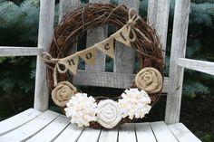 Christmas Vine Wreath/Burlap and Felt Flowers/Burlap Banner/Burlap Bow/Pinecones. $35.00, via Etsy.