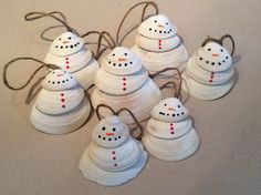 Cute little clam shell snowmen I made from shells I collected