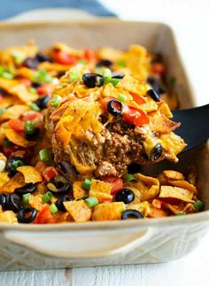 casserole recipes This Taco Casserole Recipe is loaded with all of your Mexican favorites and topped with Doritos, Fritos, or Tortilla Chips! Its easy to assemble days ahead of time and bake later for an easy dinner! Beef Casserole Recipes, Mexican Casserole, Casserole Dishes, Taco Salad Casserole Recipe, Taco Bake Casserole, Soup Recipes, Potato Casserole, Bacon Recipes, Yummy Recipes