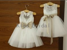 Child flower girl dress made of lace with sash bow and flowers