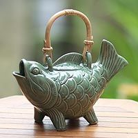 Soothing jasmine & green tea, served from the mouth of a lucky Koi