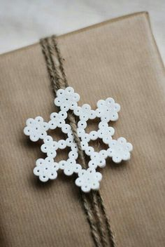 Hama bead snowflake for gift wrapping Noel Christmas, Winter Christmas, Christmas Ornaments, Xmas, Hama Beads Christmas, Hama Beads Design, Iron Beads, House Gifts, Christmas Gift Wrapping