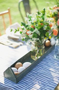 """Chicken feeders, canning jars, and blue & white striped ticking fabric ~ what a fun rendition of """"farm fresh""""! Photography by sarahmckenziephoto.com, Event Styling by twobewed.net"""