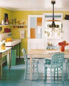 Colourful kitchen: light blue, greenish yellow, mint green, orange, white...