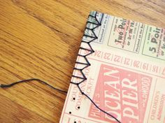 Make a hand bound journal with decorative stitching that is so much nicer to hold than a spiral bound book.