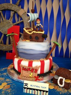 Jake and the Neverland Pirates - Jake and neverland pirates first birthday cake! Ship and treasure chest made out of RKT, all other decorations made out of fondant.