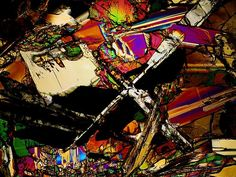 Description:  This is a photograph of a meteorite. This is a photo of a thin section of this meteorite viewed through a microscope using transmitted cross polarized light. The different colors indicate the mineral and crystal composition of this meteorite