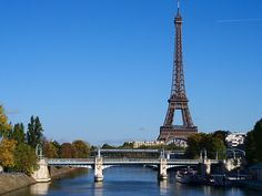 The Pont Rouelle over the River Seine with the blue sky and the Eiffel Tower in the background