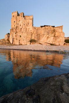 (Castello di Capo Spulico, Calabria, Italy. by Antonio Violi) Castle ruins on an island . . .