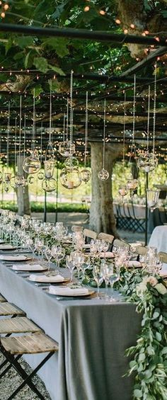 beautiful tablescape for a wedding! love the greenery garden and plenty of wine glasses!