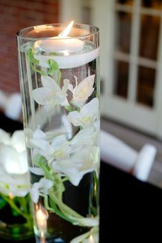 """Floating white disc candle. Neutral and beautiful, these floating candles are the perfect way to finish a water based centerpiece and DIY submersible arrangements. - 12 Candles Per Pack - 3"""" Diameter"""