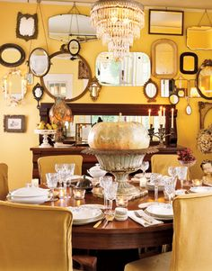yellow dining room with mirrors