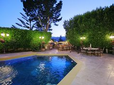 Backyard entertaining at its finest. An expansive and secluded pool area with a BBQ and outdoor kitchen.