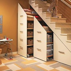 Inspiring Under Stair Storage with Smart Ideas for Designing : Under Stairs Storage Cabinets For Small Spaces On Modern Home Designed With Minimalist Cream Fronted Doors And Simple Metal Horizontal U Pull Out Handles Secret Storage, Hidden Storage, Extra Storage, Rolling Storage, Rolling Shelves, Hidden Pantry, Roll Out Shelves, Hidden Cabinet, Hidden Closet
