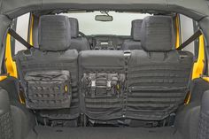 Smittybilt's new G.E.A.R. custom fit seat covers are a great place to store first aid supplies, flashlights, matches, and other essentials where they are easy to access in your Jeep Wrangler. Crafted from 600 Denier ballistic nylon, the waterproof G.E.A.R.