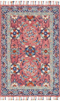 Punchy pink and cool blues give this rug an electic vibe. It'll look beautiful on your floor in your living or bedroom space.
