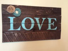 Rustic pallet wood love sign wall hanging in aqua turquoise blue home decor with burlap roses on Etsy, $35.00