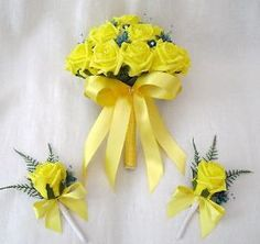 These are artificial flowers so feel free to disregard them if you're looking for real flowers.  I thought you'd like the yellow and teal incorporated into the bouquet.
