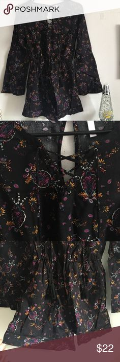 •Stunning Boho Long sleeved Printed Romper• Brand new without tags. Super cute with lace up front and tassels. Keyhole back and elastic scrunched waist  Length from top of shoulder to bottom of shorts hem: approx 29 inches. Pants Jumpsuits & Rompers