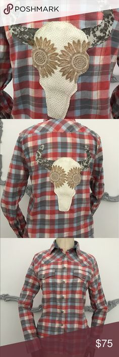 """Refashioned flannel bull skull altered boho gypsy Pair this with jeggings, jeans, shorts, or skirts for the perfect Boho Gypsy look OOAK  Women's preowned flannel shirt size M. Snap closures in front and snap on sleeve to roll up.   Measurements taken lying flat across the front Chest 19.5"""" Waist 19"""" Bottom Hem 20.5"""" Collar 15"""" Sleeve Length 23.5"""" Shoulder 16.25"""" Back Length 27"""" Front Length 26""""  Sewn on handpainted Embellishment 10.25x11.75""""   Shirt is 100% cotton Care instructions hand…"""