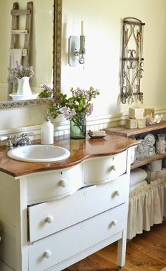 Faded Charm. Put sink on one side of the vanity to save counter space. Great idea!!