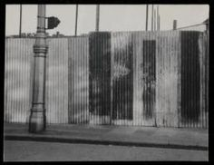 Prunella Clough 'Black and white photograph of corrugated iron hoardings'