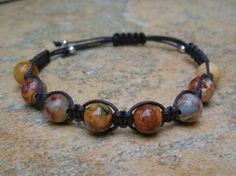 Crazy Lace Agate Healing Energy Bracelet ($15) Stunning beads. The energy feels swirly like a gentle, warm breeze which helps to gently move our energy and integrate all aspects of ourselves. Promotes balance, security, inner stability, composure & maturity Encourages self-confidence Dispels negativity and absorbs emotional pain Fosters focus and decision making