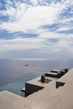 Two small houses in a small island from which we can to see the infinity. ARCHITECTURE