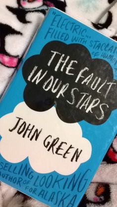 the fault in our stars, i really want this book, but for now im stuck reading it online. less do this!!!!<3
