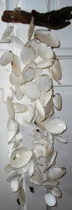 White, Shabby Chic Seashell & Sea Glass Mobile/Wind Chime. $26.99, via Etsy.