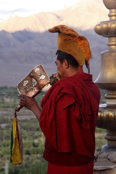 "indiaperspectives: "" Monk blowing the horn at Thiksey Monastery """