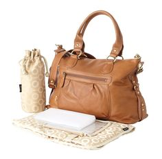 OiOi Tan Leather slouch Tote is sophisticated and comfortable bag to carry without compromising with your style. Browse our website for more leather bags.