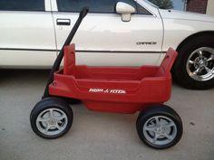 Plastic radio flyer wagon with corvette power wheels