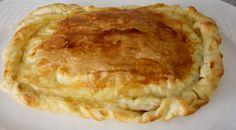 Empanada de cebolla caramelizada, queso y bacon