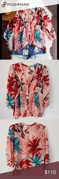 Joie Leaf Print Silk Top Beautiful leaf print semi sheer top by Joie. An almost tropical print perfect for spring and summer. Pleated detail around v neckline. Buttons down front. I did notice a pull in the Silk on the back left shoulder which I pictured in the last pic. Joie Tops Blouses