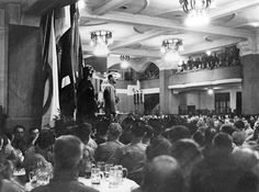 Hitler speaking in 1938 on November 8 in Munich's Bürgerbräukeller. For no reason whatsoever, this beautiful and ornate beerhall was torn down in late 1979.