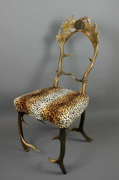 antler chair with carved horn rose