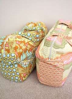 Duffel bags for the girls • only the fabric make these girly, change the prints/colours and they would be suitable for any member of the family.