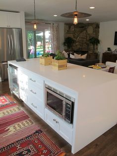 Kitchen Island--- cute but I would not want to have my microwave so low.... Difficulty when using it & too low for kids they'd be in it playing