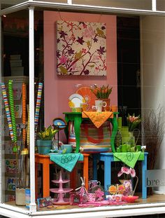 Window Dressing colorful tables could do this with chairs too Balanced backdrop