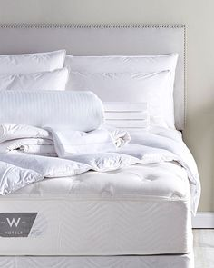 Do you sleep better in hotels? The W's mattress selection includes the Plush Top, made by Simmons (queen, about $1,600),  a feather-bed topper (about $189), and protector (about $65). All available at W Hotels The Store.