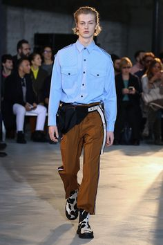 "N21 showed its Fall/Winter 2018 collection during Milan Fashion Week. ""It's a collection of clothes that I like to call classic, basic, essential, necessary. It's a vision of menswear that casts off the standardized definitions... »"