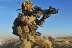 """""""Carl"""": Cpl. Carl Hines Royal Artillery provides covering fire while members of the 4 Brigade Reconnaissance Force (BRF) cross open ground o..."""