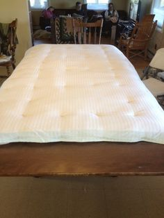 Homemade mattress topper just sew old pillows together and wrap in our bed a homemade japanese futon solutioingenieria Image collections