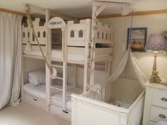 This pretty white children's room is in a Swiss mountain chalet in the famous village of Gstaad,