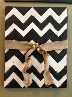 painted canvas art-  Instead of acorns, use a starfish; maybe a 'water' shade instead of black?